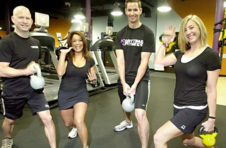 anytime fitness running man. photo by John Anderson