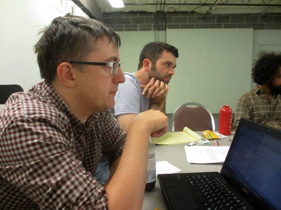 Playwright Maksym Kurochkin (l) and Breaking String Theater's Graham Schmidt at a workshop rehearsal of