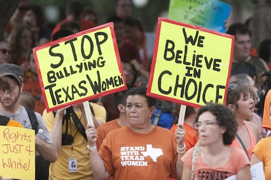 Women protest HB 2 at the Capitol this summer
