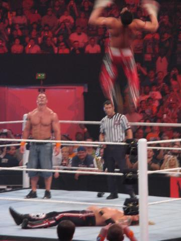 Air Bourne: WWE Champion John Cena looks on as Evan Bourne delivers a shooting star press to Edge during Monday Night Raw at the Frank Erwin Center