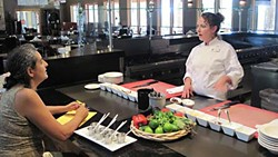 Travaasa culinary instructor Tricia Freeman in the demo kitchen for her Summer BBQ class