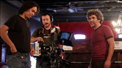 Mario Troncoso (r), producer of KLRU's <i>Arts in Context</i>, on location with camera operator Juan A. Izaguirre (l) and boom operator/sound mixer Isaac Hammons (center)