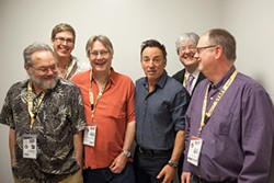 Wrecking Crew: (l-r) SXSW brain trust Louis Black, Hugh Forrest, Grulke, Bruce Springsteen, Andy Flynn, and Roland Swenson, SXSW 2012. The Boss is actually tickling Grulke.