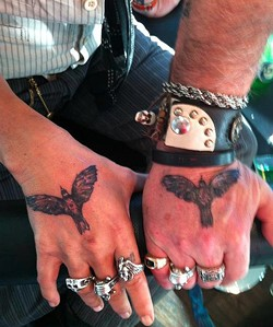 Hands down: Depp (l) and Carter share three tattoos. These were inked last year during the Toronto Film Festival, which screened the West Memphis 3 documentary executive produced by Depp.