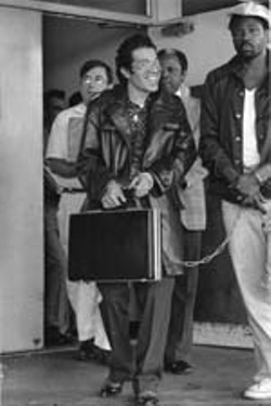 TDCJ inmate and prison reform activist David Ruiz leaving court in 1978 (with briefcase)