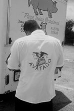 Polo Cadena inspects a taco stand during AVATACO's citywide census drive.
