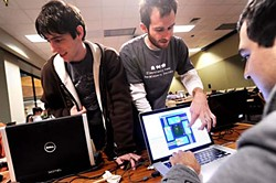 Joey Harding (center) advises local Global Game Jam participants.