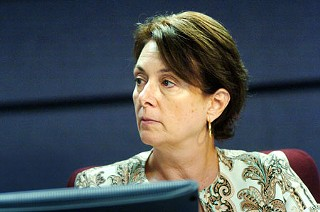 "AISD board trustee Annette LoVoi said ""no"" on each of three votes to axe teachers and staff."