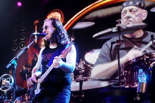 Big screen Neil Peart oversees Geddy Lee at Rush's Erwin Center shakedown, June 12.