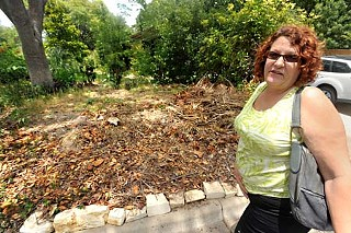 A work crew from the city's Urban Forestry division showed up at Laura Croteau's home early the morning of June 30 and hacked down her shrubbery, leaving a large barren spot in Croteau's yard, a certified Wildlife Habitat.