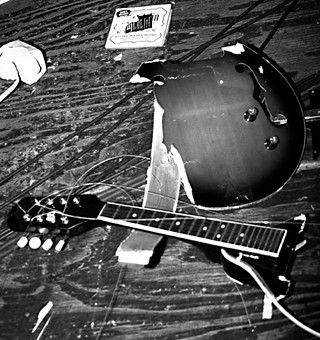 Playback's beloved A-style mandolin, beaten to death onstage at Jovita's, March 11, 2011