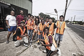 Participants in HEROES (Helping Everyone Recognize Opportunity and Excellence in Self) is a seven-week day camp that's helping to clean up the neighborhood. Angela Walton, Dorian Layssard, and Angela Alexander run the program.