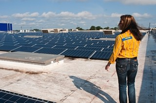 IKEA operations manager Amy Jensen surveys the sun-soaking tiles as they ready to produce electricity for the Round Rock IKEA store