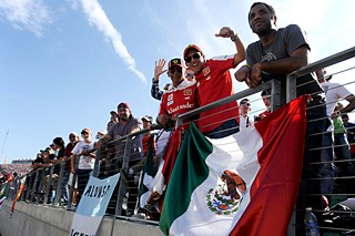 Fans wave a Mexican flag on race day, Nov. 18. Austin-born former driver Tavo Hellmund, who was instrumental in getting Formula One to Austin, was the son of a man who promoted motor sports in Mexico.