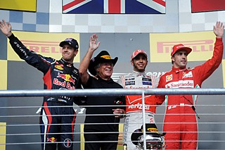 Left: (l-r) Sebastian Vettel (Germany, second), racing legend Mario Andretti, Lewis Hamilton (United Kingdom, first), and Fernando Alonso (Spain, third).