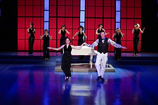 Santa brought somebody tap shoes: Elizabeth Koepp, Matt Gibson, and chorus in <i>White Christmas</i>.