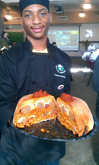Connally High senior Jaleun Foster holds the <i>timpano</i> inspired by the Italian part of his heritage.