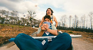 Emile Hirsch (top) and Paul Rudd in the burned-out forests of Bastrop