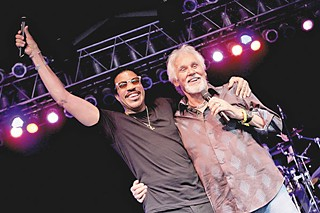 Lionel Richie (l) joins Kenny Rogers as a surprise guest during the 2012 Bonnaroo Music and Arts Festival.
