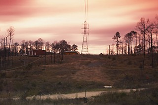 The towers of the LCRA line that crosses in front of Lisa Nolan's property served as a marker for the beleaguered homeowner when she made her escape as smoke filled the area soon to be consumed by fires.