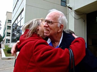 Fran and Dan Keller embrace outside the Travis County Jail