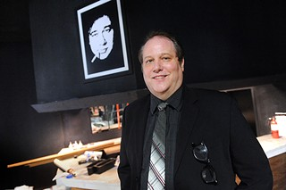 Bill Hicks (l) looks on at David Cotton inside the Roost.