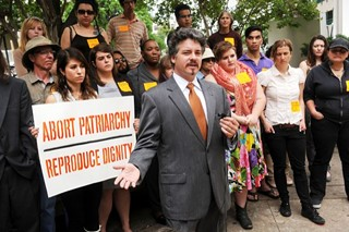 Attorney Paul Quinzi speaks during a Rise Up Texas press conference April 21