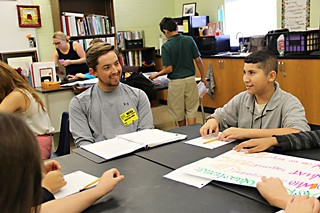 UT Law student and volunteer Danny Williams (l) works with students through the Youth Court at Webb Middle School.