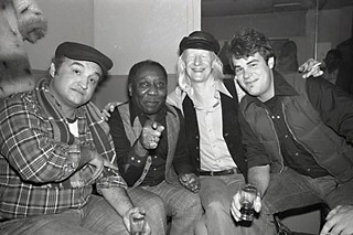 Blues Brothers: (l-r) John Belushi, Muddy Waters, Johnny Winter, and Dan Aykroyd