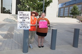 Pro-choice protesters gathered outside the courtroom on the first day of the HB 2 trial.