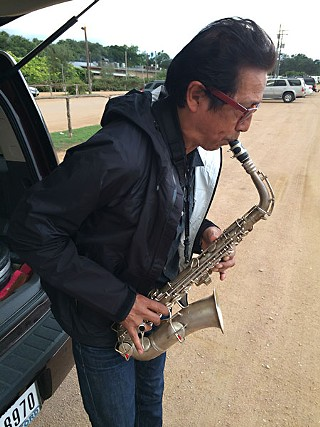 Bird calls: Alejandro Escovedo with his latest pawn shop acquisition - Charlie Parker's preferred mode of expression, alto sax
