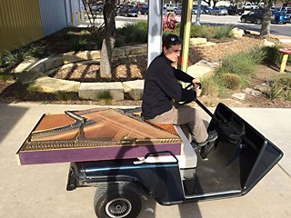 Sound artist Mark McCoin with his golf-cart piano