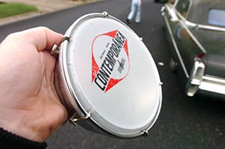 Weapons of Mass Syncopation: Willy Abers of Ozomatli dropped this drum when he was grabbed from behind and arrested by APD Officer Owings. Police accused drummer Jiro Yamaguchi of hitting Owings in the head with his bass drum.