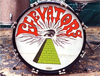 Austin artist John Cleveland designed the pyramid-and-eye album cover and adapted it into the logo on John Ike Walton's drums.