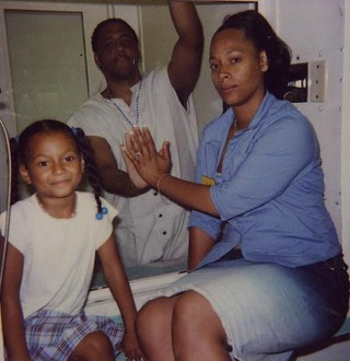 Kenneth Foster with his girlfriend, Nicole Johnson, and their daughter, Nydesha, during a 2001 visit to Texas death row