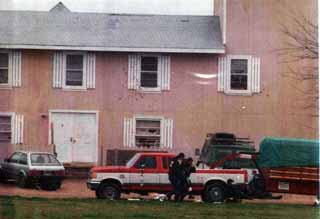 ATF agents retreat from Mount Carmel after the raid.