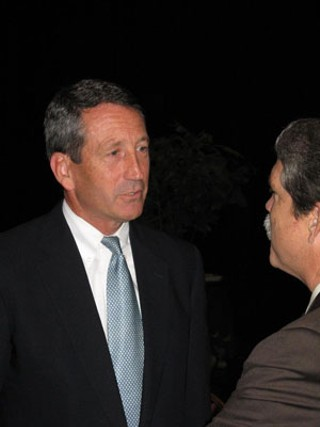 Gov. Mark Sanford (l) talks to Texas House Republican Caucus Chair Larry Taylor, back in happier times
