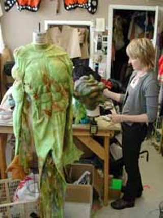 Designer Kari Perkins of Star Costumes with costume and mask for Gollum