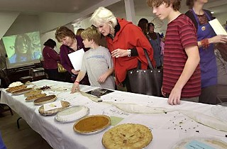 Guests bidding on pies at last year's silent auction.