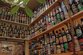Shelton's collection of beer bottles.