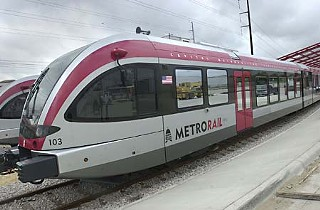 MetroRail test runs are causing long delays on Justin Lane, near the North Lamar/Airport Boulevard crossing gate.
