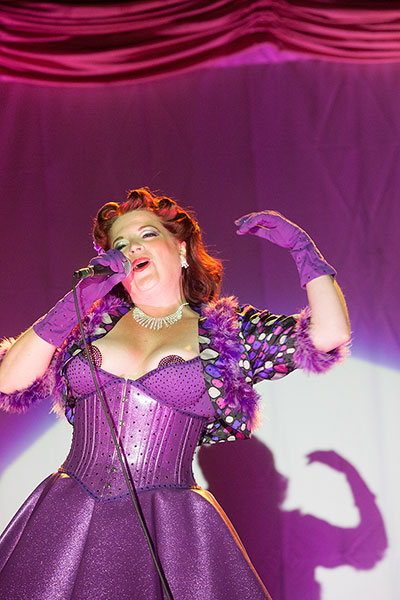 Emcee Cora Vette of Denver, Colo. hosts Friday's Night of Legends at the Texas Burlesque Festival.