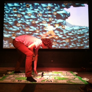 Jan Willem Nijman attempts to scale the virtual wall of <i>Mega GIRP</i>.