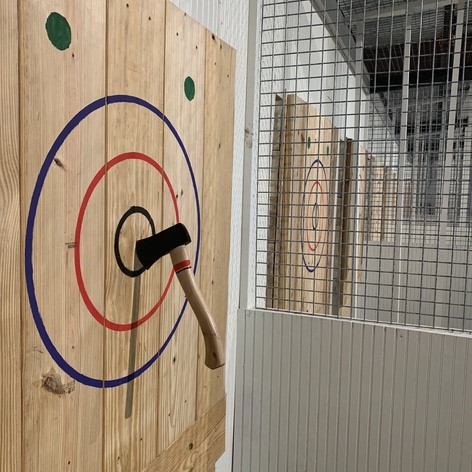 Hachet Alley Adds a Twist to Axe-Throwing: Why just throw axes when you can bowl with a football? - Chron Events - The Austin Chronicle