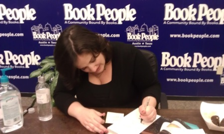 Deb Perelman signs a cookbook