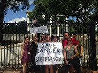 Activist Posts Up At Gov Mansion to Protest Cancer Screening Cuts