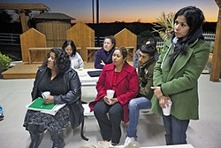 Las Lomitas residents, including NA Treasurer-Elect Mary Escalante (far left) and President-Elect Maria Avila (far right), met last week to discuss the community's water problems.