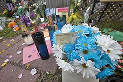 Flowers, candles, and notes placed outside Barrera's home