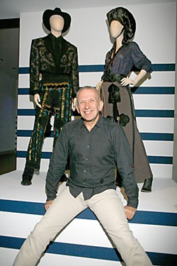 Jean Paul Gaultier stood at the entrance of his retrospective at the opening night, greeting guests and signing copies of the catalog.