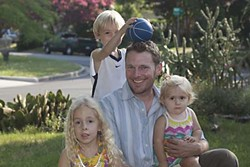 The Zilker Neighborhood Association's Andrew Elder – pictured with his children Ani, 5; Madoc, 3; and Bevan, 14­ months – opposes allowing commercial short-term rentals in the neighborhood.